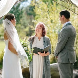 Couple saying vows at RiverSong Inn