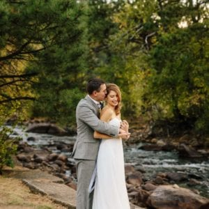 Wedding couple kiss by river