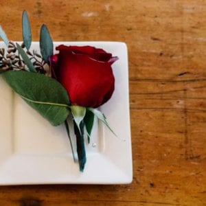 lovely rose boutonniere on plate