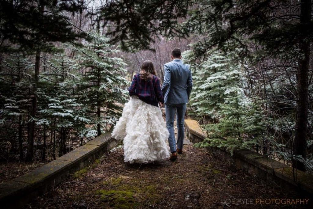 Couple walk through forest